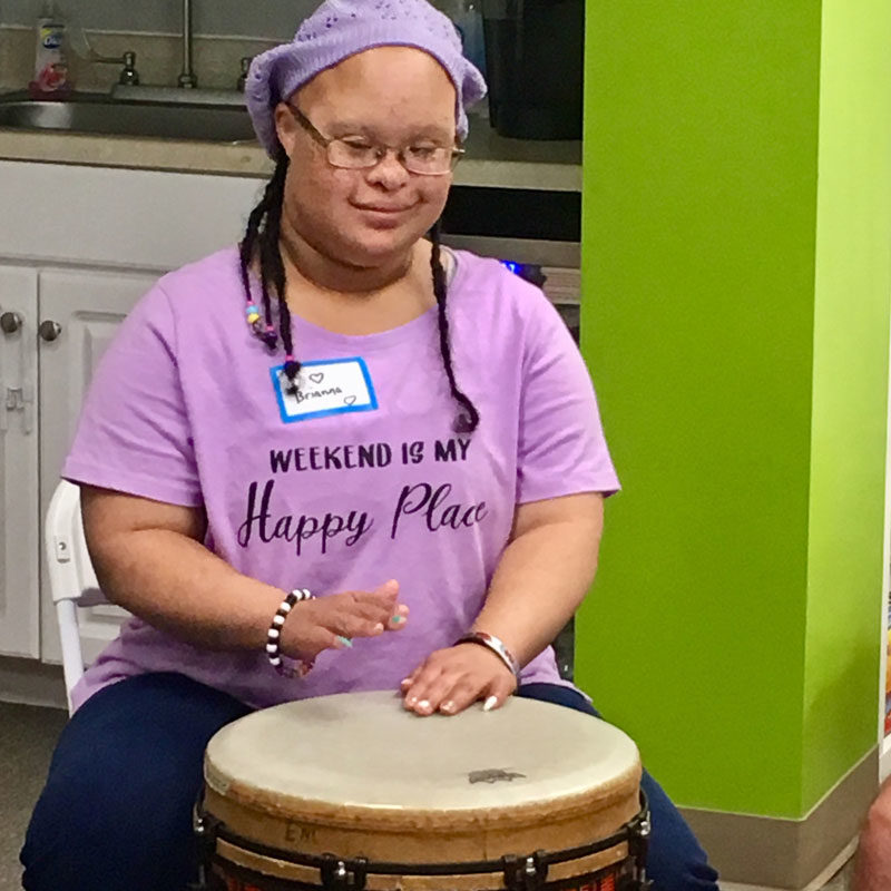 GiGi's Playhouse Annapolis, Girl with Down Syndrome playing drums